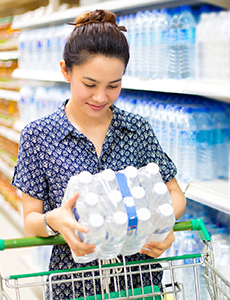 Choosing bottled water at a supermarket