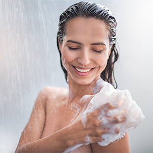 Person enjoying a shower while lathering soap