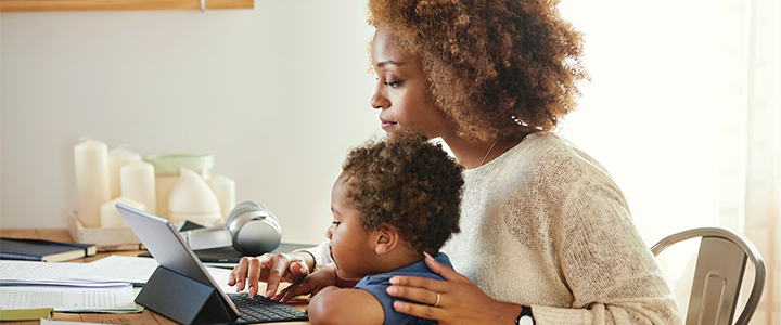 A mother reviewing finances with her child