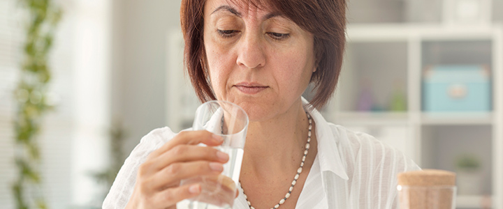 Woman questioning the contents of her water