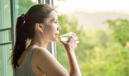 Woman drinking a fresh glass of water